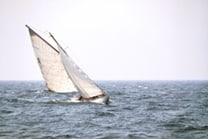 sailboat heeling to left - Navigating The Difficult Channels Of The Real Estate Industry
