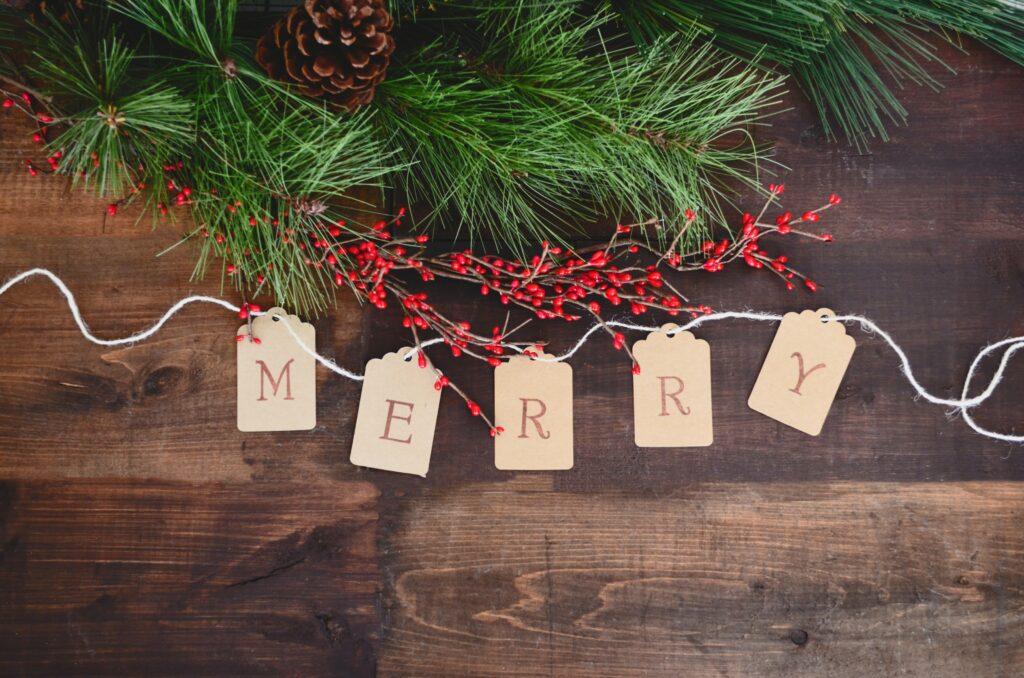 Christmas greenery and berries wtih words Merry in wooden tags on front - Christmas Decor Inspiration