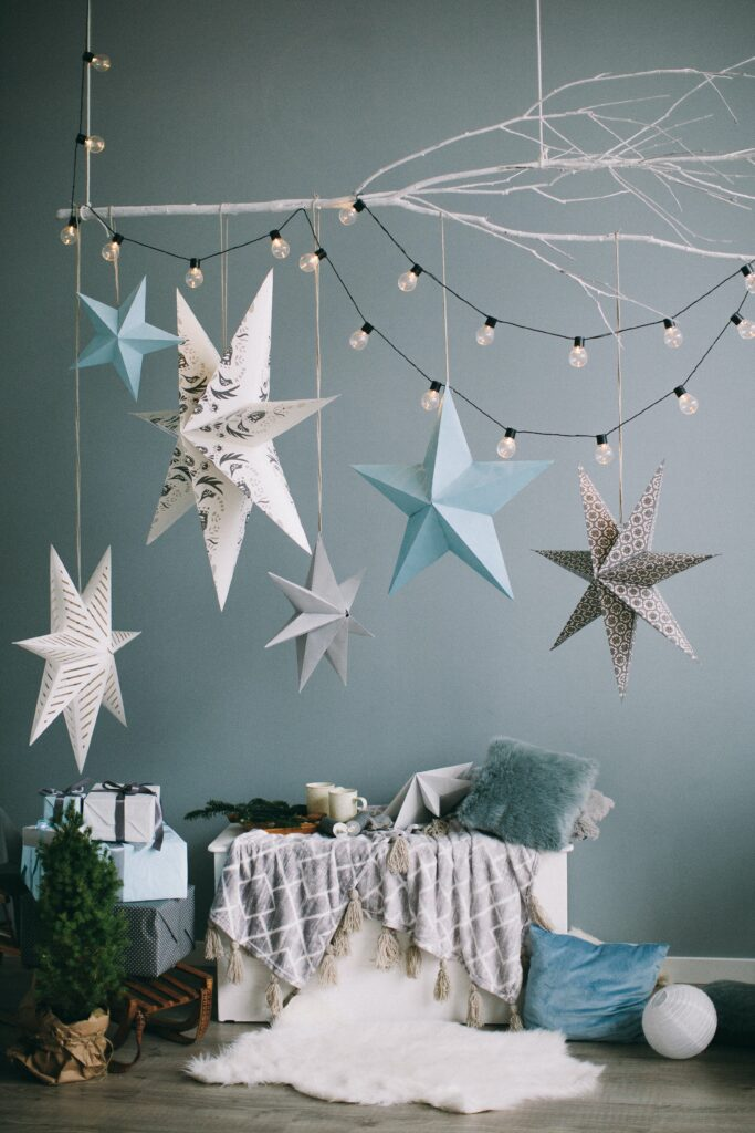 Hanging paper stars and string lights - Christmas Décor Inspiration