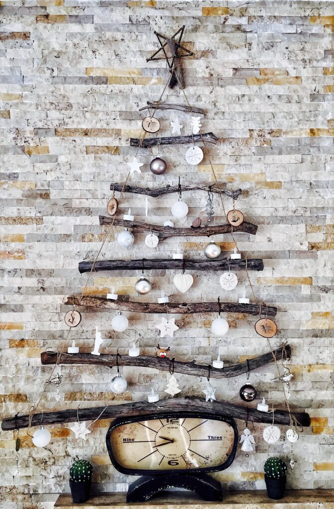 Wall Christmas tree created with branches, ornamens and a clock -Christmas Décor Inspiration