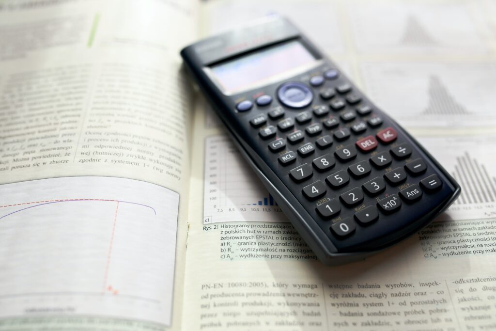 graph and calculator-How to Calculate the Purchase Price of Your Investment Property