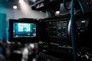 video camera showing image of woman public speaking - Video Marketing