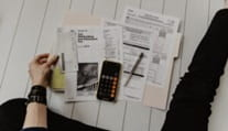 woman's hand and foot beside income tax espenses - what expenses can you claim for your retnal proeprty?