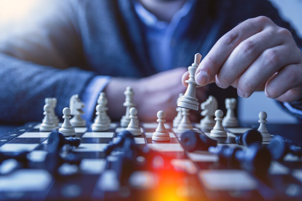 man playing chess, why buy-rent-hold stragegies are good investments