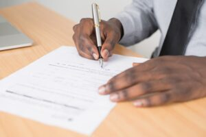 black man completing paper application - The Residential Tenant Applicatioin - what to ask