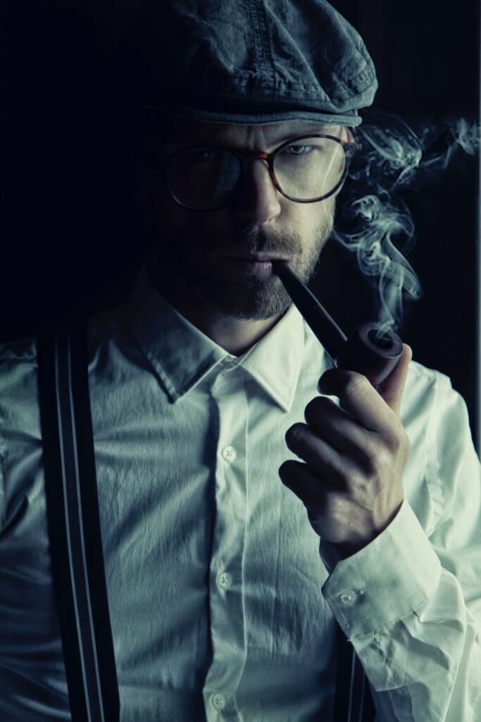 male detective smoking a pipe - Landlord/Tenant FAQs