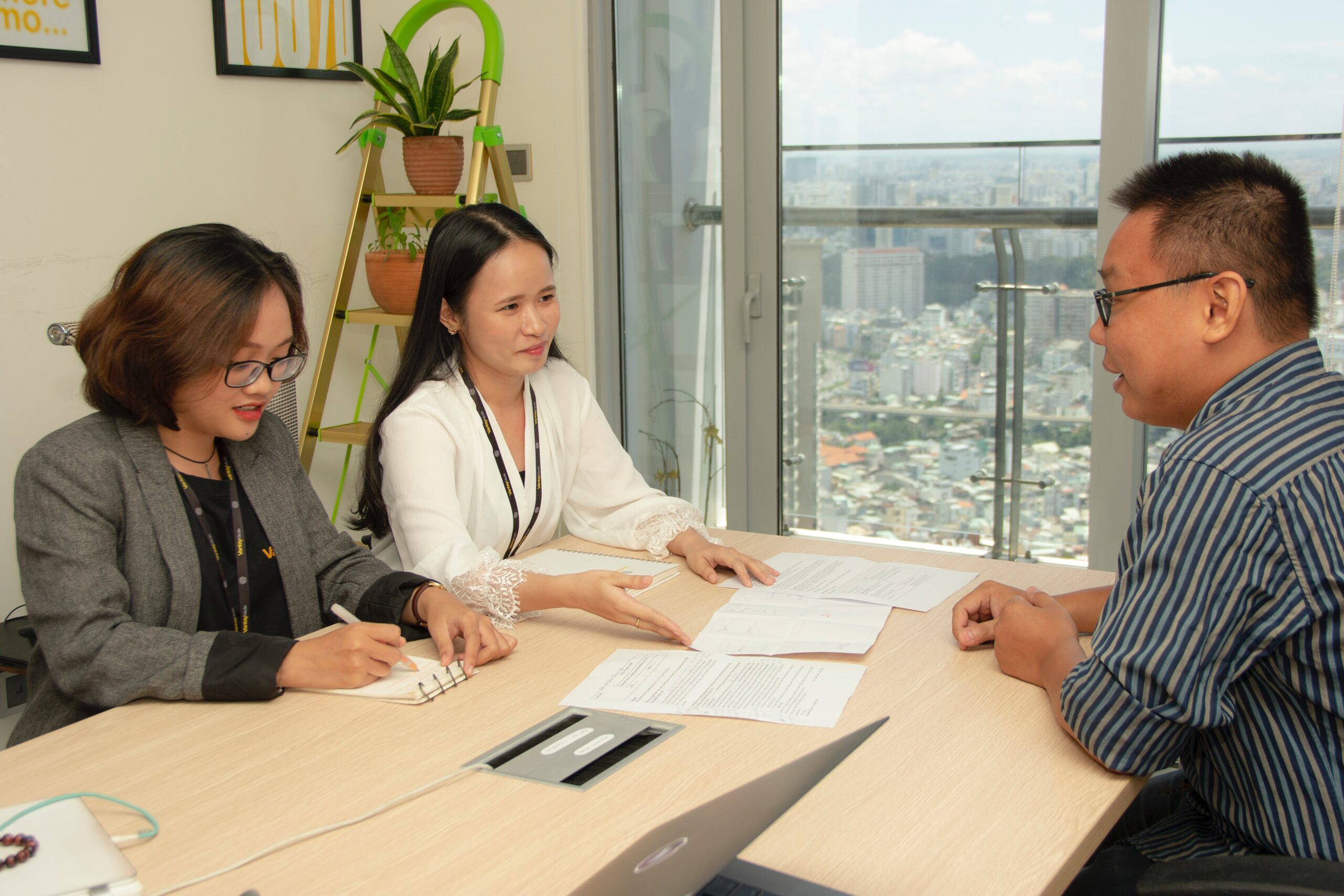 two women interviewing a man in an office-21 Critical Questions to Ask Before Hiring A Property Manager