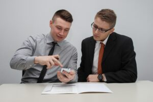 two men in suits arranging financing - What is seller financing?