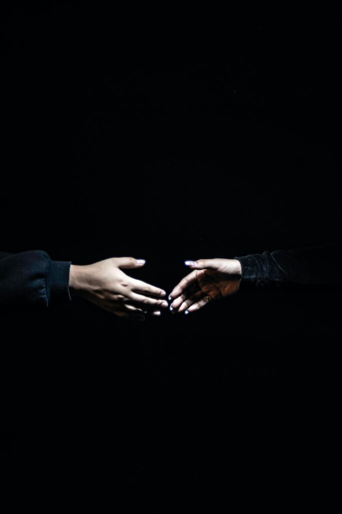 hand shake on black background -Curb Appeal- how well does your property interview?
