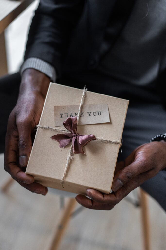 man presenting a gift - Tenant Appreciation – do you say thankyou?