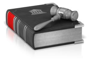 legal book with gavel resting on top - The Residential Tenancies Act (RTA)—Landlord/Tenant Rights and Responsibilities
