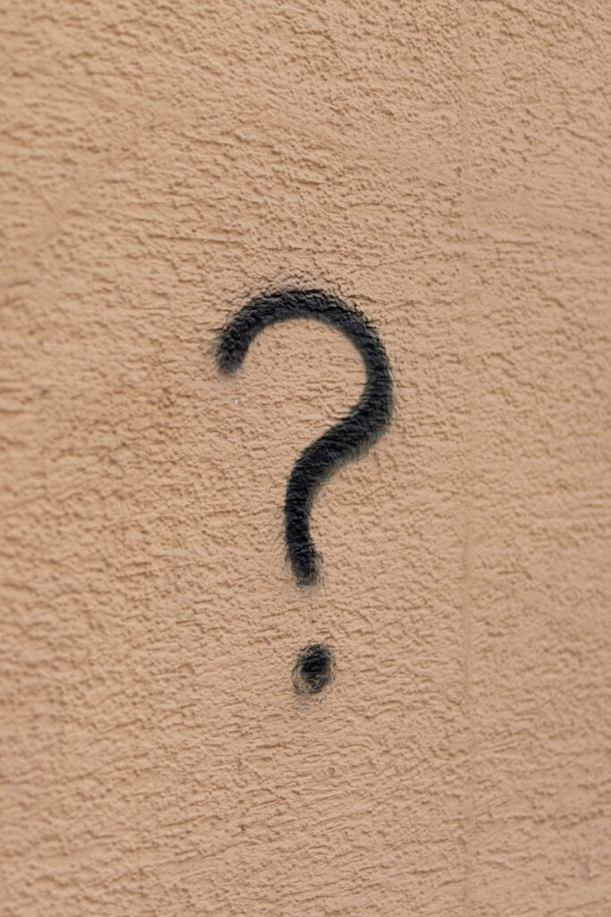 black spray painted question mark on beige wall -Test your landlord knowledge – Landlord FAQs