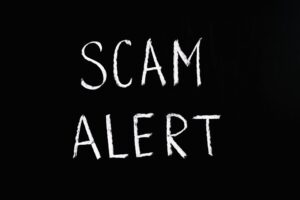 """white words """"scam alert"""" - How to spot fake tenant referenceson black background -"""