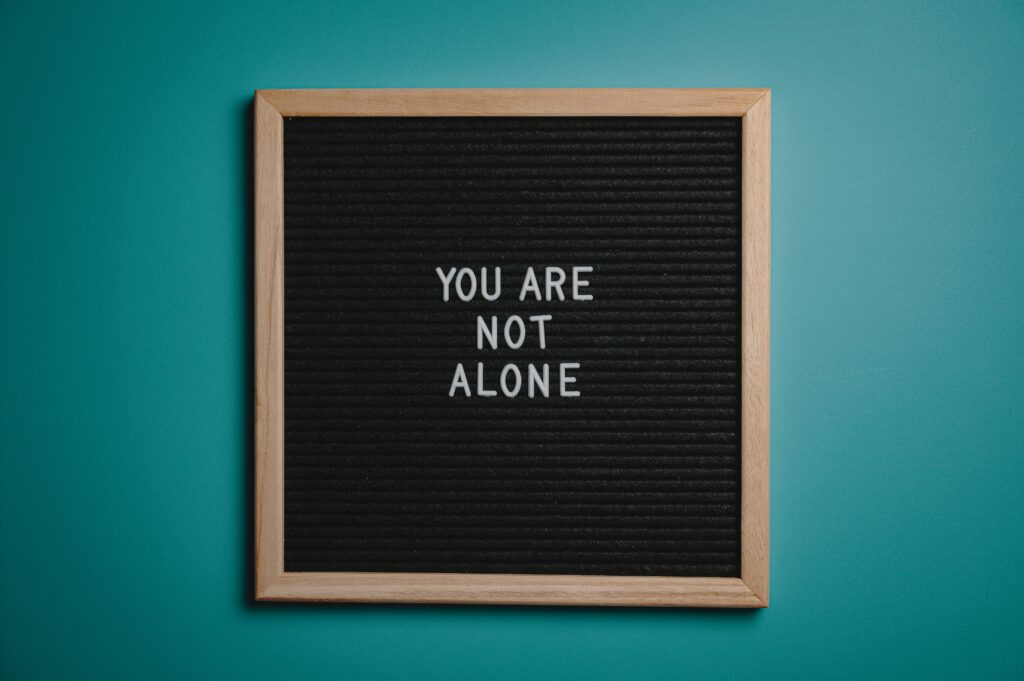 """blackboard withwhite words """"you are not alone"""" Saskatchewan Landlord Resources"""